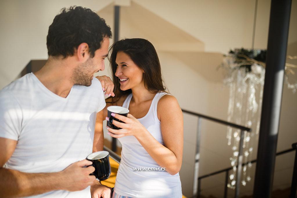 Affectionate couple enjoying  morning coffee and flirting