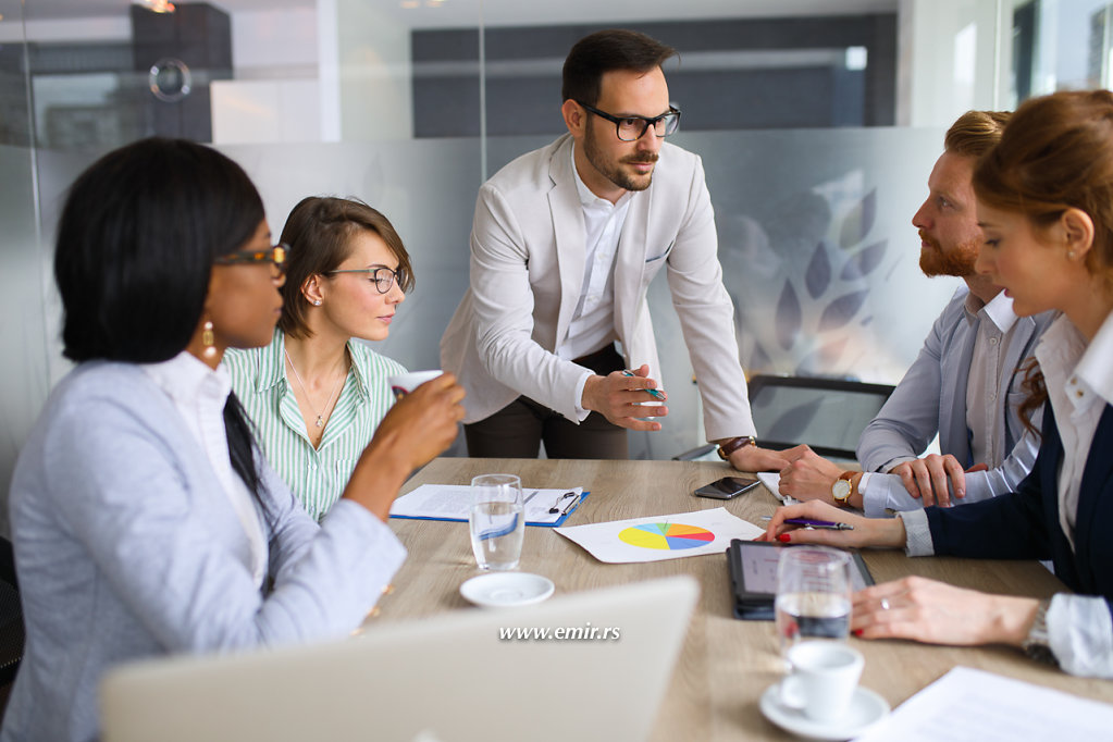 Businessman explaining business plan to coworkers